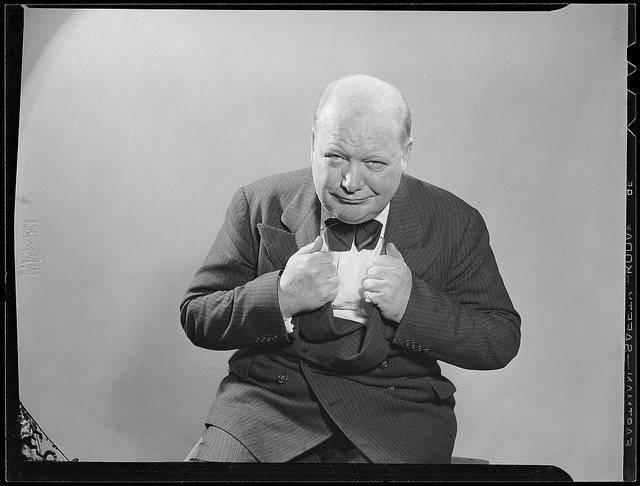 Customary pose from Winston Churchill during visit to Boston