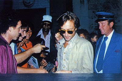 John Lennon with autograph hunters in 1980