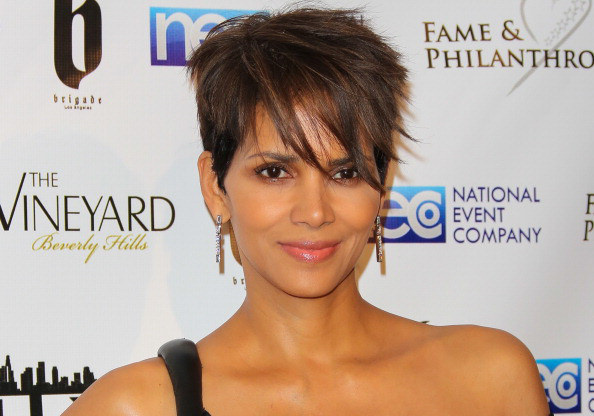 Halle Berry shows off her curves in tight dress
